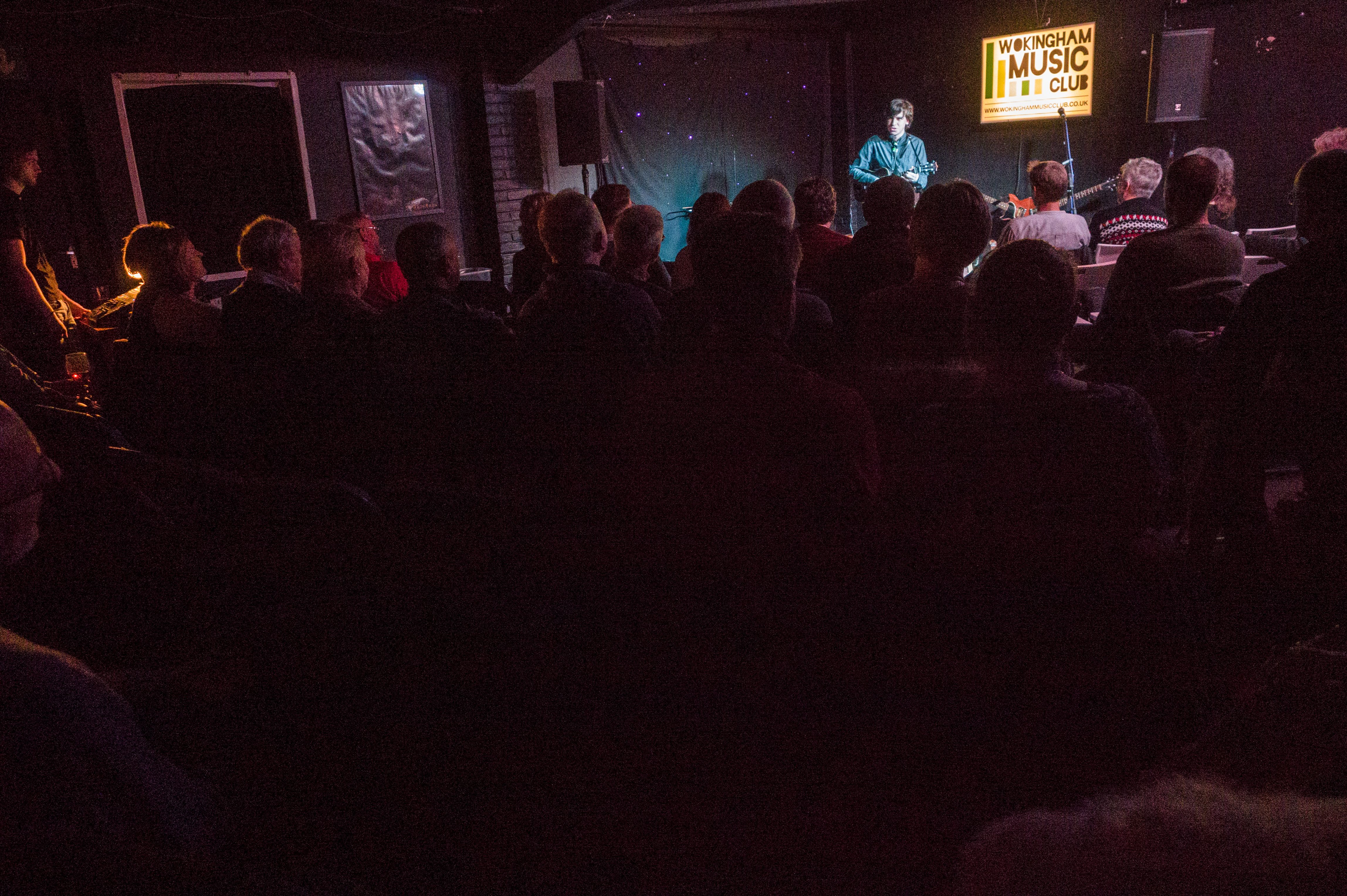 Matthew entertains a crowd at the Wokingham Music Club, as a support act for John Otway